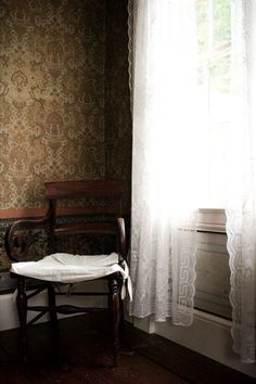 Hena Tayeb Photograph Of An Empty Chair In Room