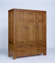 The Santana Rustic Oak collection is made using partially reclaimed oak, with a rich patina finish to accentuate the grains of the timber. Substantial in size and build, this range has been crafted both to last and to impress. Pieces in the range inclu Buy Wardrobe, Triple Wardrobe, Wardrobe Drawers, Solid Wood Bedroom Furniture, Home Decor Furniture, Dining Furniture, Timber Furniture, Furniture Ideas, Large Wardrobes