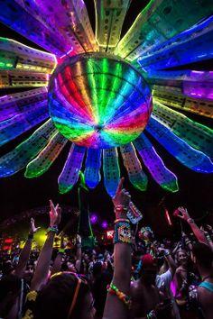 RAVE IT UP, light lovers! Dig the LED rainbow flower daisy @ EDC; rad shot. Now I wanna dance.