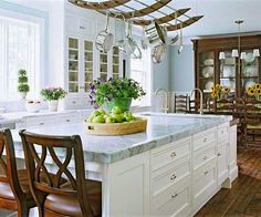 Sky blue walls, off-white cabinets, and rich woods create a cozy and inviting atmosphere Glass Front Cabinets, White Cabinets, Eat In Kitchen, Kitchen Dining, Kitchen Ideas, Kitchen White, Kitchen Decor, Shaker Kitchen, Decorating Kitchen