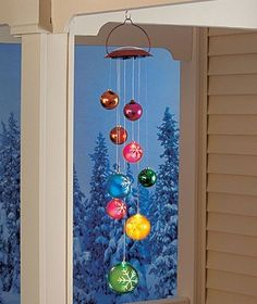 Christmas Ornament Decor: I want to do something similar to this but from my dinning room ceiling fan