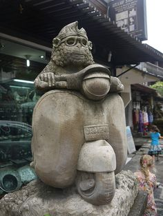 Monkey on a Vespa statue, Jalan Monkey Forest, Ubud, Bali, Indonesia. Photo by Indounik. Monkey Forest, Vespa, Bone Carving, Ubud, Pendant, Handmade, Monkeys, Etsy, Statues