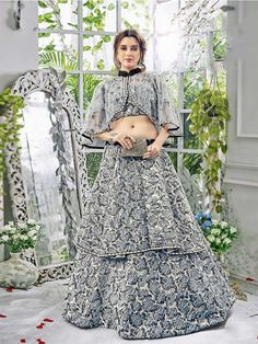 Buy semi-stitched bollywood inspired grey indo western lehenga choli from stunning collection of indowestern lehengas in new designs at affordable price in uk. ZaraaFab offers vast collection of lehenga choli for women who value style and comfort.  #greylehengacholi #indowesternlehenga #bridalenghas #indianwedding #bridallehenga #lehengacholi #ghagracholi #designerlehenga #womenlehenga #weddinglehenga