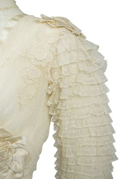 Edwardian Wedding Dress with original Veil. The dress is made of creamy dotted…