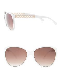 Show off your fierce style with chic sunglasses featuring goldtone chain accents on each earpiece. #LaneBryant