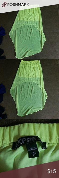Like new neon yellow express skirt Like new neon yellow express high low skirt size small Express Skirts