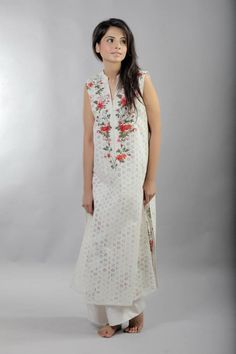 Item: Oasis - White chikan w/ red flowers    Product Code: O1    Model: Marvi Sarfraz    Makeup: Bina Khan    Photographer: Kohi Marri