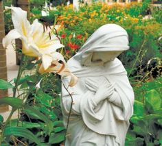 Mary in the garden, so humble...