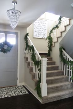 Christmas Entryway with Fresh Garland and 'It Is Well' Hymn Canvas - Life On Virginia Street