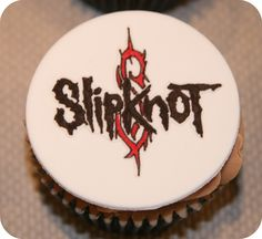Slipknot  Heavy Metal Cupcake// this may be the deciding idea! Tiers of cupcakes with our fav band names, hearts, stars, music notes, etc. Large cupcake on top for the Anniversary cake. Bride & Groom hands w/ rings throwin up horns, connecting together!!!!!