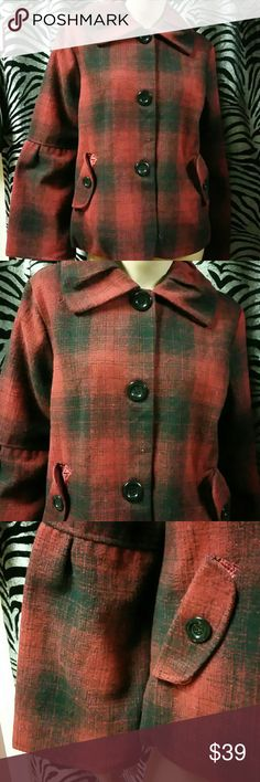 """Oleg Cassini red plaid swing jacket. Size XL This jacket or short style coat is perfdct for Fall or winter. The collar and belled sleeves, along with the large black buttons and flared at the waist, gives it a vintage style look. This coat is NWOT. No signs of wear. Wool, polyester and nylon blend. Sleeves are over sixed and measure approx. 24.5"""". Length of coat is approx. 26"""". Bust measures approx. 36"""".  Two front pockets. Oleg Cassini Jackets & Coats"""