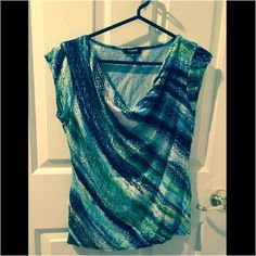 Sleeveless multi-colored blouse. Petite Medium. Gently used blouse. Sleeveless can be dressed up or down. Premise Tops Blouses