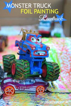 Monster Truck Foil Painting Racetrack by Crayon Box Chronicles.  Easy to set-up, uses recycled materials cardboard, paper towel tubes, and foil.