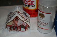"Putz houses, also called ""glitter houses,"" are little houses that make up a Christmas village. Popular from the 1920s on, they can be made from cardboard, card stock, and even old Christmas cards."