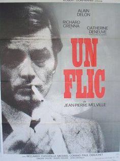 """film poster showing alain delon in """"un flic"""" by jean-pierre melville"""