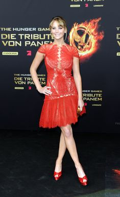 The Hunger Games Germany Premiere, 2012 A true lady in red in this lace mini, paired with matching red pumps.