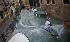 Duncan Zuur of the Netherlands rides a wakeboard along a canal next to flooded St. Mark's square in Venice, Italy on December 2, 2008. (REUTERS/Handout/Euro-Newsroom.com/Joerg Mitter) #