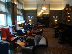 Fringe trimmed wing chairs. The Coburg Bar, Connaught Hotel, London. Designed by India Mahdavi.