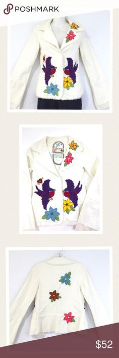 """💕SALE💕 Joystick hand embroidered jacket. 🎉Host Pick🎉 This creamy white cotton corduroy jacket has exquisite hand stitched embroidery and excellent craftsmanship. It features lots of artistic details such as stitched elbow patches, eyelet lining, slightly belled sleeves with eyelet trim and two tiny Joystick bird pins attached to front faux pocket. The cut of fabric creates a flattering fit to showcase this lovely work of art. 🔹Like new condition 🔹Bust 32"""" 🔹Length 22"""" 🔹Sleeve length…"""