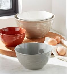 Our set of four ceramic mixing bowls debuts warm autumnal colors in cinnamon, taupe, cream, and grey each with ridges on the exterior for added visual interest.
