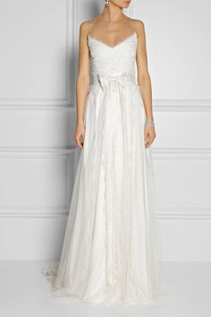 Marchesa's ivory gown echoes modern romance - Chantilly lace and tulle are beautifully draped over a full satin skirt, trailing to an elegant train. Grosgrain shoulder straps and an internal boned bodice provide support and ensure a flawless fit.