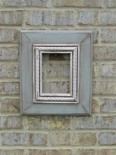 5x7 Grey Frame with an Antique White rope trim. distressed and glazed