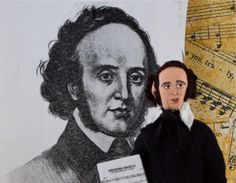 Felix Mendelssohn was a German composer, pianist, organist and conductor of the early Romantic period  Born: 1809 Died: 1847  A perfect gift for the musically inclined or lover of classical music, Felix is created out of wood, wire, clay, and paint. I gave him a period costume of black pants, long black coat, high necked shirt, and black cravat tie. I added real fiber hair and a tiny, detailed , hand painted face. For the final touch, he holds a copy of one of his works…