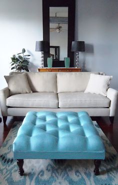 DIY Ottoman:  How to Make a Tufted Ottoman with Wood Legs...love fabric ottomans which is why I have pinned so many!