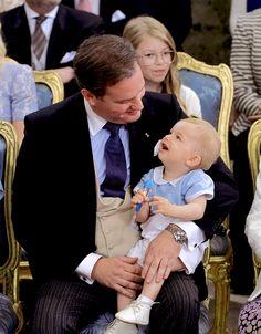Christopher O'Neill shares a sweet moment with his son, Prince Nicolas, at the christening of Prince Oscar.