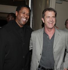 Actors Denzel Washington (L) and Mel Gibson pose at an industry screening of Universal Picture's and Imagine Entertainment's 'American Gangster' at the ArcLight Cinemas on October 29, 2007 in Los Angeles. California.