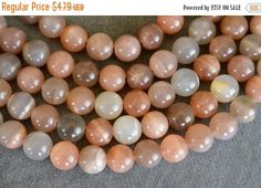 Amazing, natural peach moonstone beads are a smooth, round beads measuring 8mm.  Beautiful moonstone has a shimmery quality, and these are shades of peach white, clear, and a bit of light gray in some.  These are truly gorgeous, stone pieces for a memorable design!  Stone is untreated.  You will receive 10 beads.    ~~~Please see announcement on shop home page for current information on deals, offers, and shipping.~~~      COUPON CODES: Only one coupon can be used per transaction. Enter at…