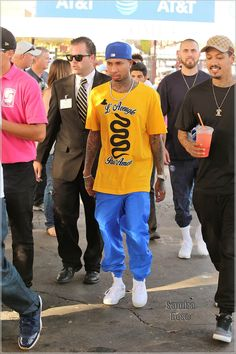 For some reason rapper Tyga was surrounded by bodyguards at a National Football Leagu...
