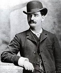 """Apr 16, 1881 Bartholomew """"Bat"""" Masterson has his final gunfight in Dodge City, KS in defense of his younger brother Jim. Jim was in a dispute with a business partner and employee that had lead to gunfire, but no one was harmed as yet. Bat took the train from Tombstone & confronted the men. A gunfight ensued. A bystander is wounded and one participant is shot in the lung. Bat paid  fine and took the train out of Dodge City that evening."""