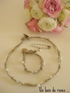Ensemble collier bracelet et épingle.