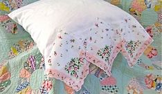 lovely hankie edged pillow, and beautiful quilt under it