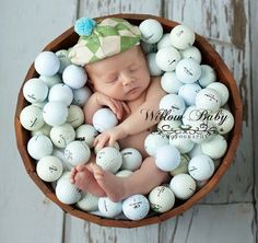 Super adorable newborn golf photo of baby in a bucket of golf balls! More cool golf ideas at #lorisgolfshoppe