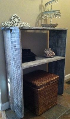 Recycled fence boards with a light coat of dry brushed white paint make a unique entry table.