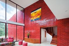 Our fiery red Glazed Thin Brick color, Catskill is not for the faint of heart. With subtle touches of variation and rich, weathered texture, our red brick is sure to make a bold statement. Brick Design, Tile Design, Glazed Brick, Open Plan Kitchen Living Room, Fireclay Tile, Brick Architecture, Timber Door, Brick Facade, Brick Wall