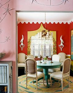 The dining room is painted Starburst Orange above the chair rail and Chartreuse below. The Brighton Pavilion-style wooden valance is painted Apple Green. All by Benjamin Moore. Wool-and-hemp Pleasure Palace rug designed by Doug and Gene Meyer for Niba Rug Collections