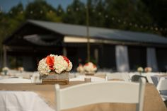 our wooden boxes wrapped with hydrangeas and roses arranged on site. Photo by Leah Langley