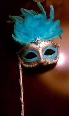 Idea for reception.  Get a bunch of inexpensive masks for tables and take a picture with everyone wearing them.