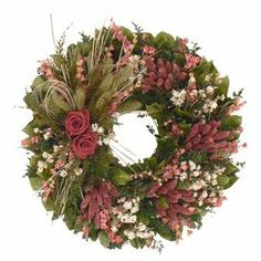"Adorned with pink larkspur and roses, this charming wreath is a welcoming accent in the entryway or displayed above your mantel.   Product: Preserved wreathConstruction Material: Silicone Color: Green, pink and whiteFeatures:  Includes natural leaves, caspia, larkspur, setaria, natural sinuata, roses and fern  Handmade   Dimensions: 18"" Diameter x 6"" DCleaning and Care: Avoid sunlight, moisture,  heat and humidity. Wipe clean with a dry cloth"