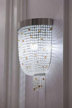 AL RUFAA CELEBRATION HALL COMPLEX   Sans Souci ... wall brackets of a sparkling crystal bead net in all corridors of the wedding complex. Crystal Light Fixture, Light Fixtures, Crystal Beads, Crystals, Architectural Features, Wall Brackets, Glass Design, Cut Glass, Light Decorations