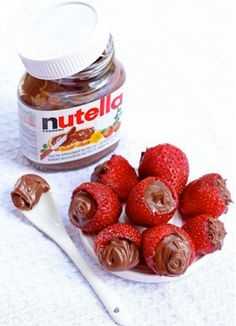 Nutella and strawberries. Nothing has ever been more perfect. I have to try this! All I have been eating is Nutella and pretzels.