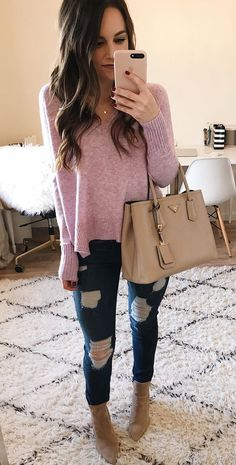 #fall #outfits women's pink v-neck sweater and distressed blue-washed jeans. Click To Shop This Look.