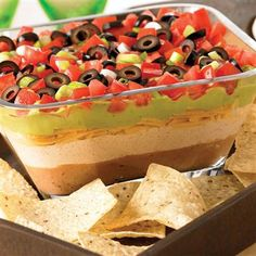 #colorful #harvest #recipe Seven Layer Fiesta Dip - I can't even tell you how popular this dip is at our house.  This Fiesta Dip is a huge hit at our house and not just for the holidays either.  We make this dip often.  It has all of our favorite goodies in it: refried beans, sour cream, shredded cheese, tomatoes, guacamole, onions and black olives   Simple, delicious and always a requested dish.