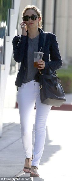 Keeping it casual:The TV star wore a grey tee tucked into her skinnies and ditching her h...