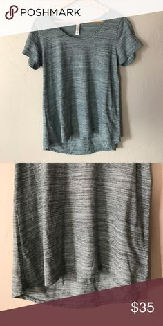 Lularoe Classic Teal Excellent condition. Underarm to underarm 17.5 inches, longest length 27 inches, shortest length to front 24.5 inches. All measurements are approximate and taken when laying flat. 58% polyester, 42% cotton. Machine wash cold, hang dry. #3030 { Bin 7} LuLaRoe Tops
