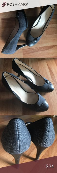 Nine West Gray and Black Pumps w/ Snap Detail 8.5 Gently worn pair of Nine West pumps in size 8.5 M. Beautifully classic and versatile dark gray and black with a cute pretend snap detail across the front. Perfect for business casual offices, or pair them with some skinny denim for a polished weekend look! Some very slight wear to the heels and soles (see photos). These do not come with a box. Make an offer! Nine West Shoes Heels