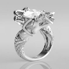 An AWESOME Cushion Cut Created White Sapphire Rhodium Plated Sterling Silver Women's Mermaid Engagement Ring By Jeulia. Take advantage of this Valentine's deal at a price of $259.95 marked down from $988.95. Price and availability determined by the supplier.